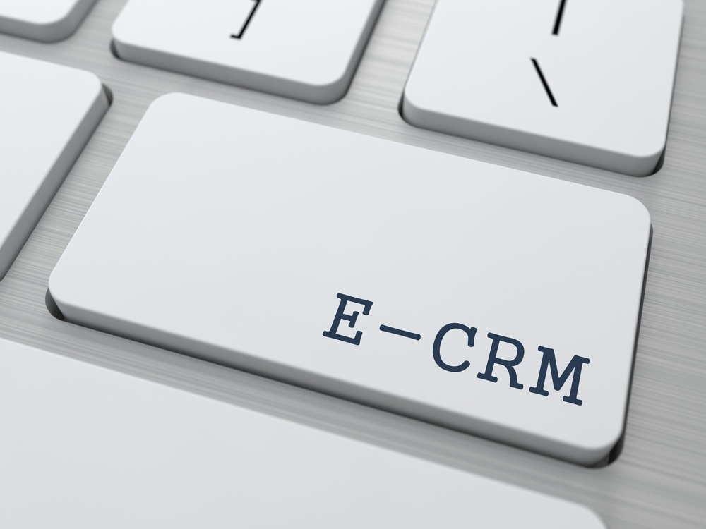 E-CRM. Information Technology Concept. Button on Modern Computer Keyboard. 3D Render.