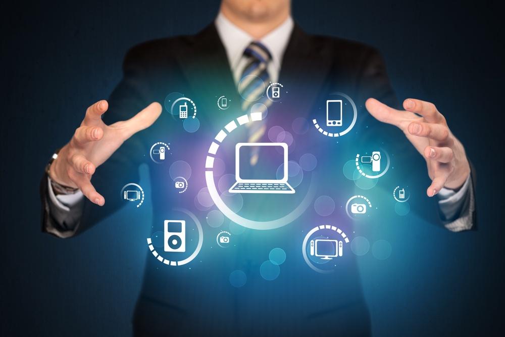 Businessman holding digital media icons