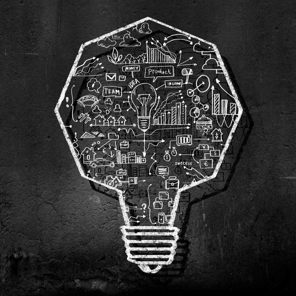 Conceptual image of light bulb on black wall