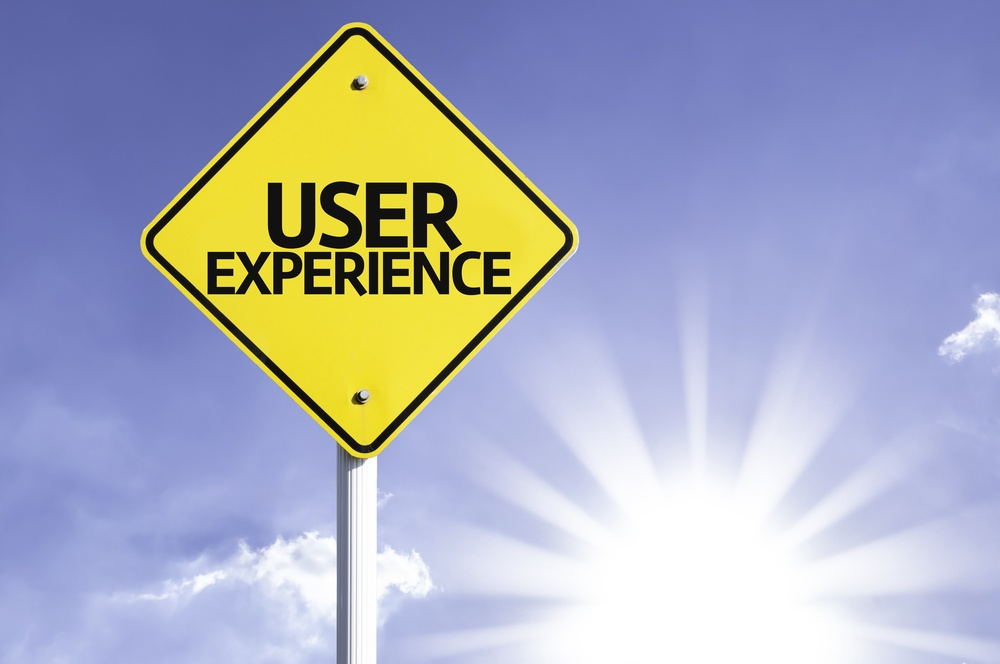 User Experience road sign with sun background